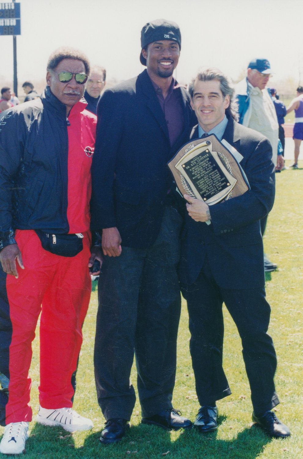 Late East Rockaway resident Dr. Ken Leistner, right, who died suddenly on April 6, is remembered for training others to be the best they could be. Above, Leistner with Derrick Adkins, the 1996 Olympic gold medalist in the 400-meter hurdles, center, and Lakeview Youth Federation co-founder Charlie Nanton.