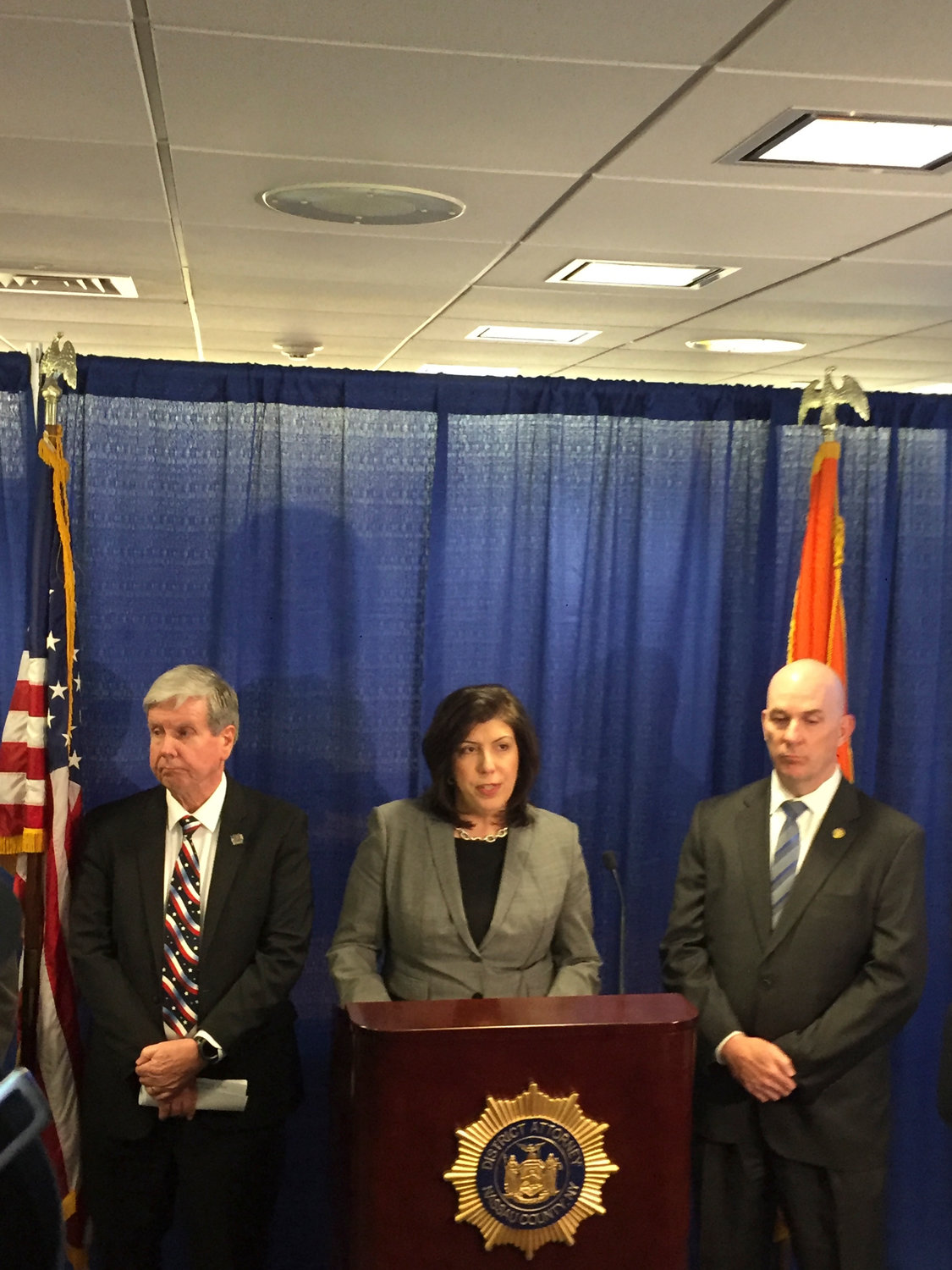 Nassau District Attorney Madeline Singas outlined the charges on April 17 against six alleged MS-13 gang members who allegedly murdered two individuals in December. On her right was John Ryan, the chief Queens assistant district attorney, and on her left was Thomas DePaola, the Nassau deputy chief of detectives and assistant chief.