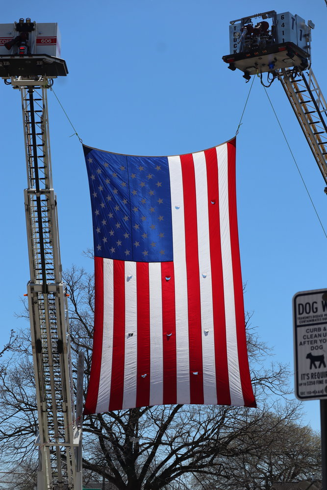 The Bellmore and Merrick Fire Departments raised the American flag in honor of Thomas DeFrancisci.