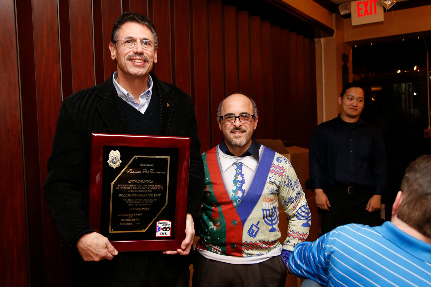 Scott Resnik, right, chief of Bellmore-Merrick Emergency Medical Services, was on hand when DeFrancisci was named an honorary chief of the organization.