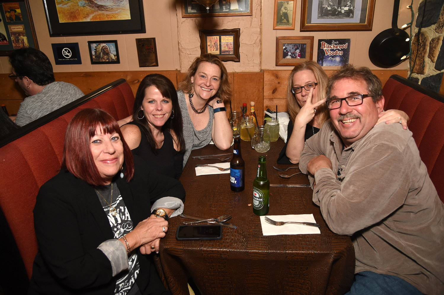 Twenty-year R.S. Jones regulars Robin Atlast, left, of Oceanside; Trish Morzillo, of Merrick; Barbara Shine, of Massapequa Park; and Susan and Eric Halvorsen, of North Merrick.