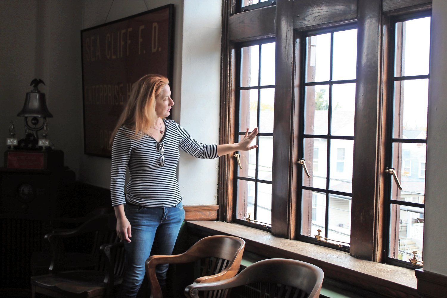Erinn McDonnell, the Village of Sea Cliff grant writer, looked out onto Roslyn Avenue through the newly restored windows of the Sea Cliff Firehouse.