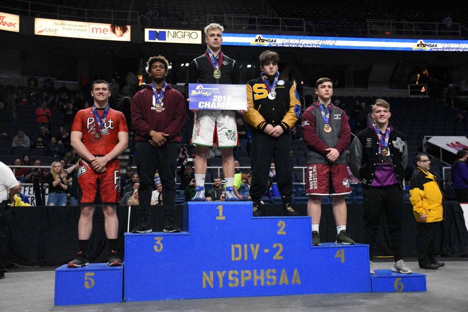 W.T. Clarke High School wrestler Karl Bouyer, second from left, earned third place at the New York State competition this winter.