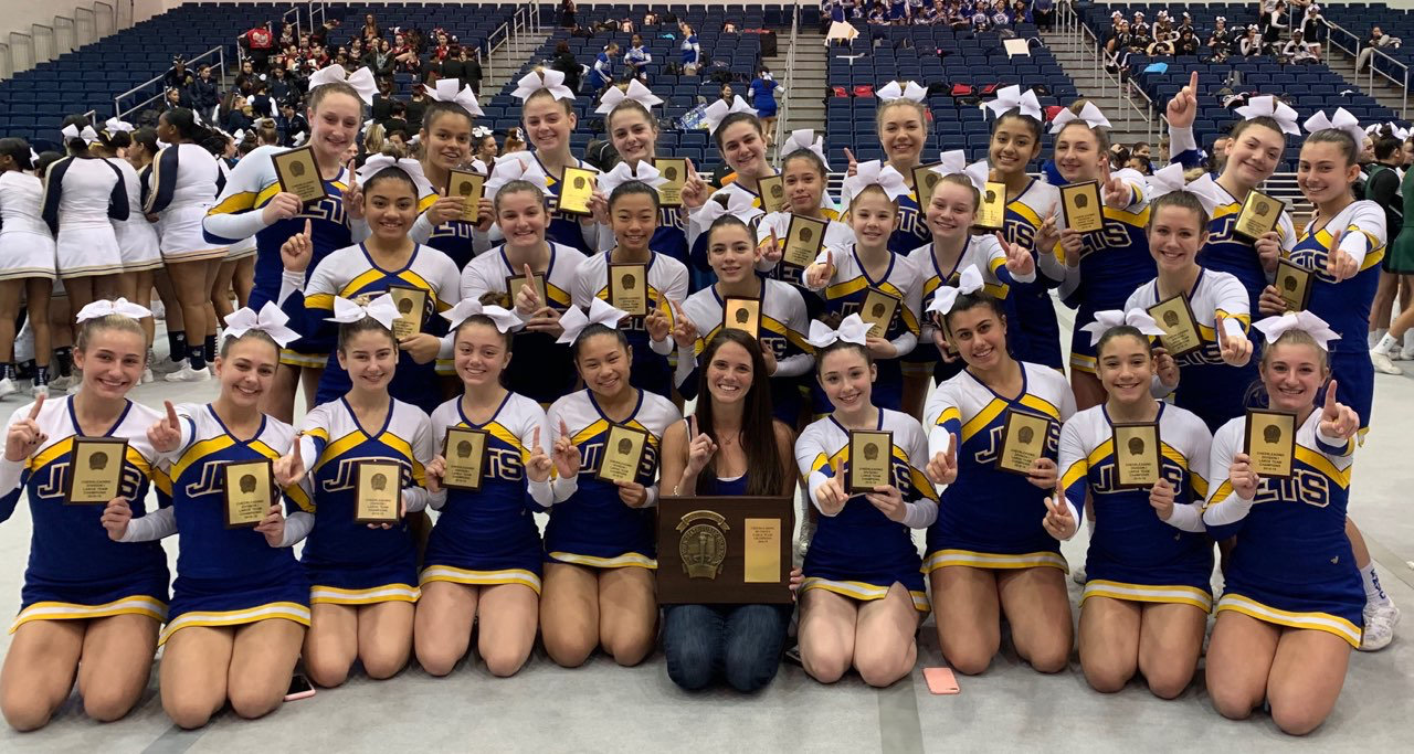 The East Meadow High School cheerleading team won a third straight Nassau County Championship this winter.