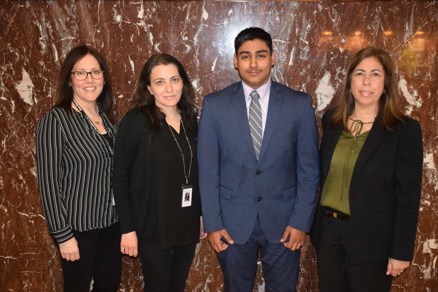 East Meadow High School freshman Kush Upadiyay, second from right, became the first East Meadow High School student to qualify for the ICDC national round with a third-place finish at the state round in March. Pictured, from left, with teacher Laura Mohring, assistant principal Christina Egan and business chairperson Toni McIntosh.