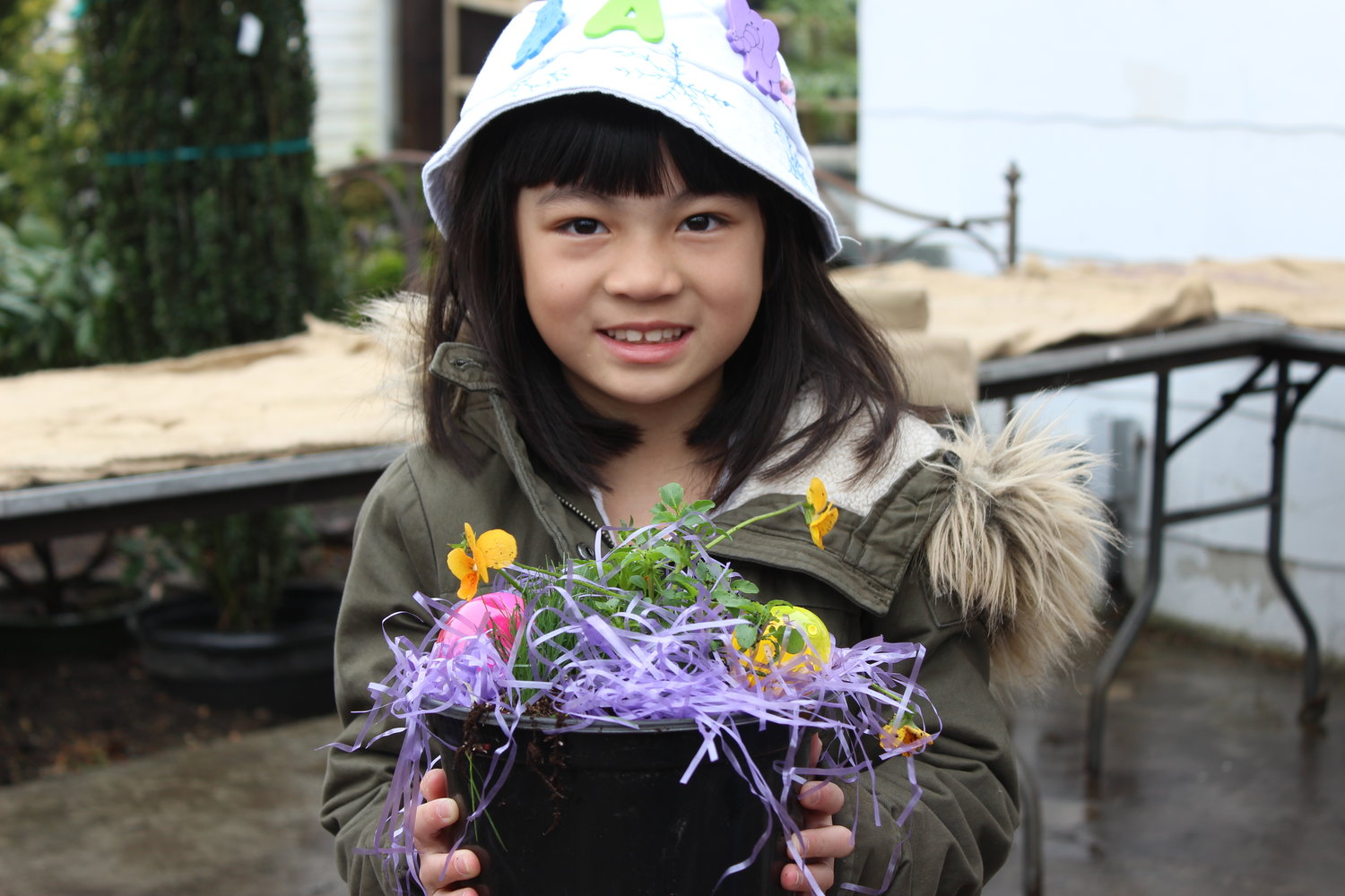 Alina Chan, 7, of North Bellmore, decorated a spring flower at Cipriano during last year's Easter festival.