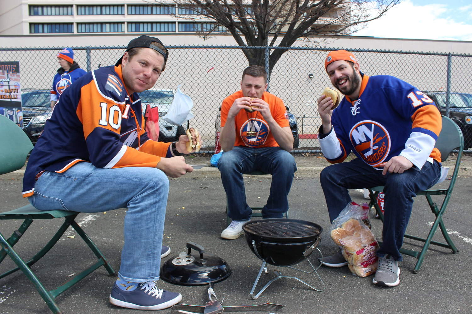 Monteleone, center, and his friends Dave Cote and Nick Christofides had a barbecue set up by noon in preparation for the Islanders' April game against the Pittsburgh Penguins.