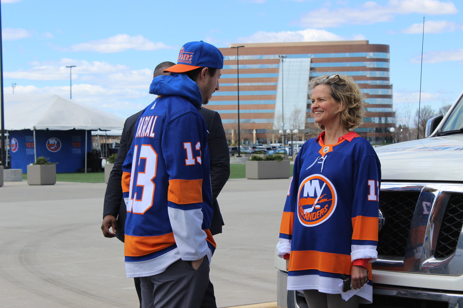 Curran spoke with Jordan Baptiste, left, who traveled from the city of Orleans in Ottawa, Canada, to see the Islanders pay at Nassau Coliseum for the first time.