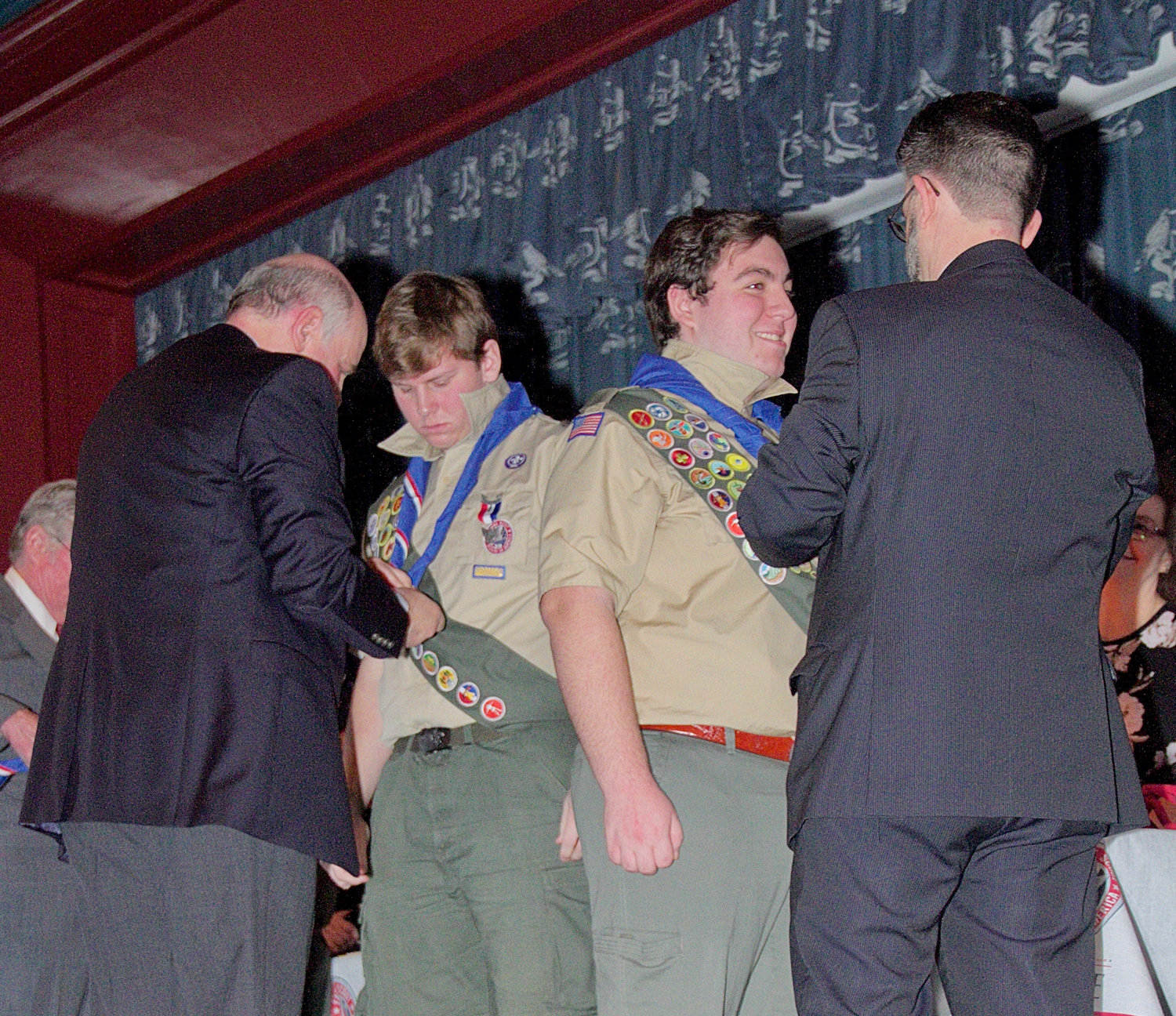 Arthur Johnson, left, helped his son, Kristofer, with his new Eagle Scout neckerchief, as did Jordan Masiakos, with his son, Steven.