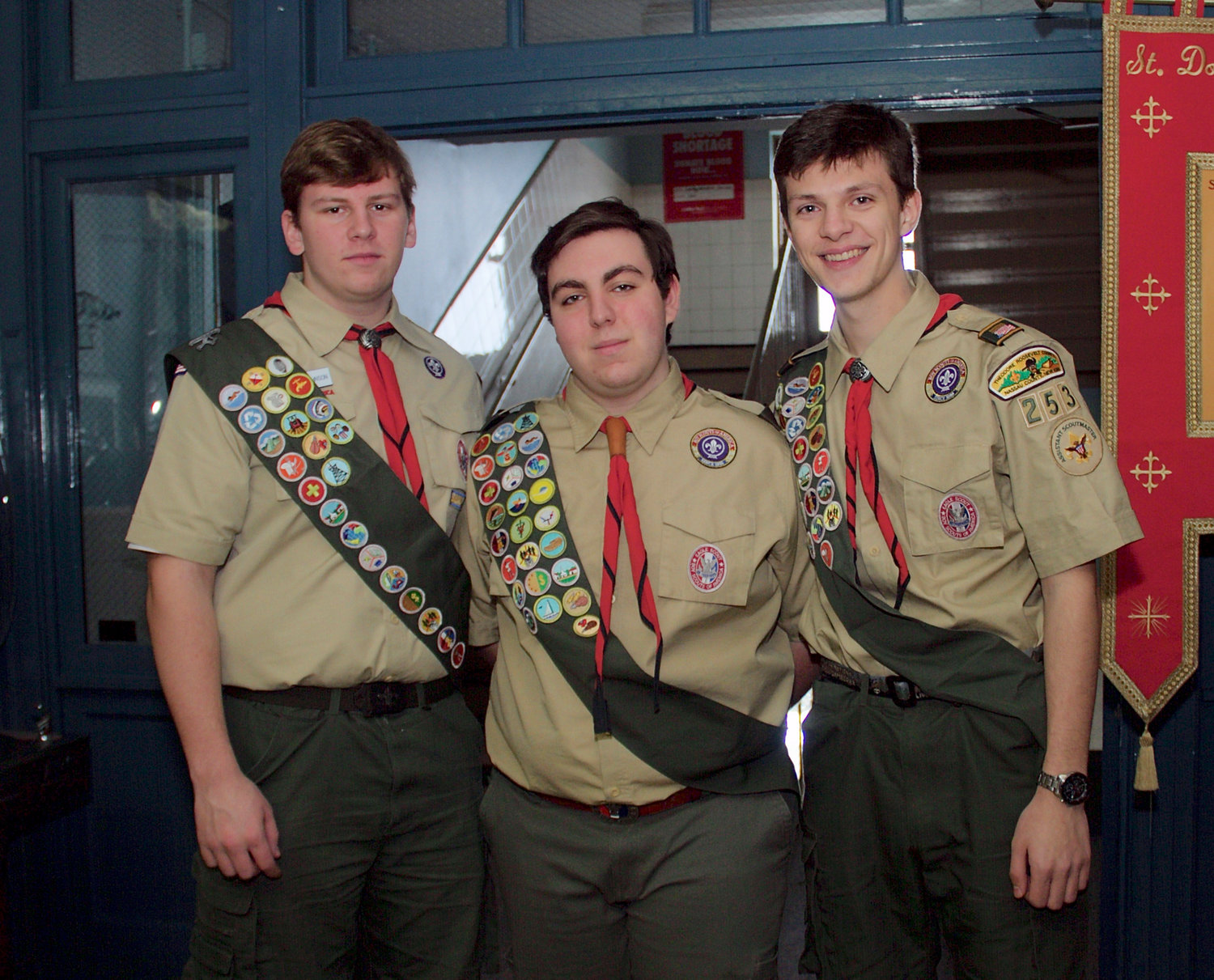 Friends  Kristofer Johnson, far left, Steven Masiakos and Christopher Syrett before the Eagle ceremony.