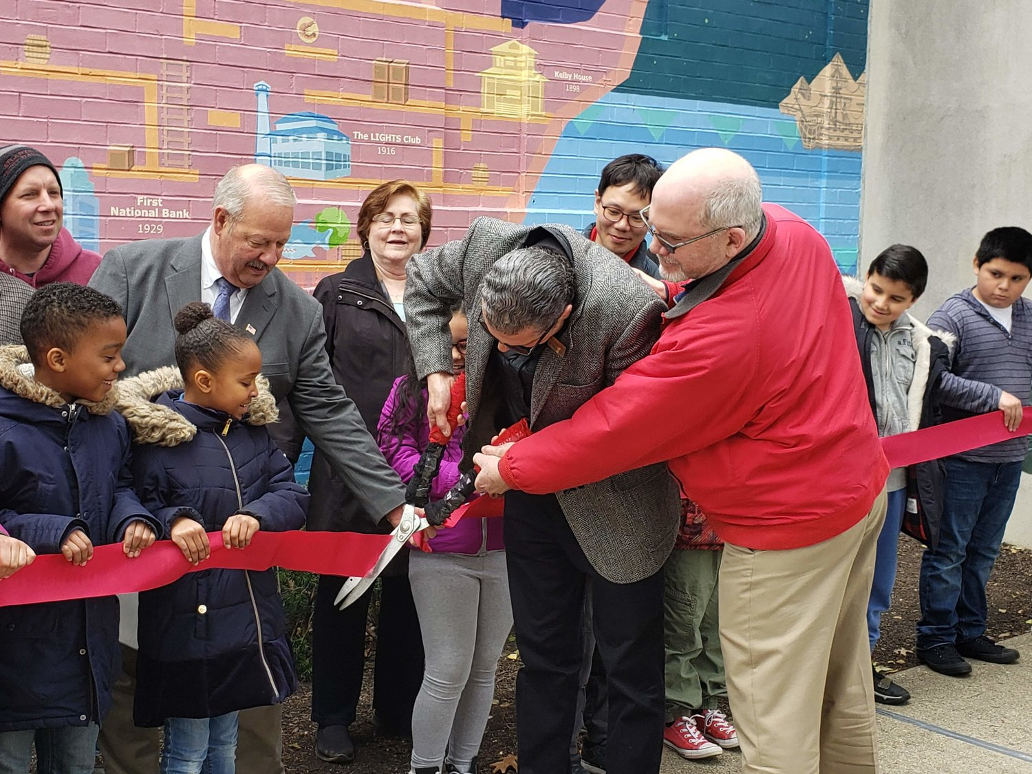 The Long Island Arts Council at Freeport and the Freeport Memorial Library held a ribbon-cutting ceremony to celebrate the unveiling of the new mural last Saturday.