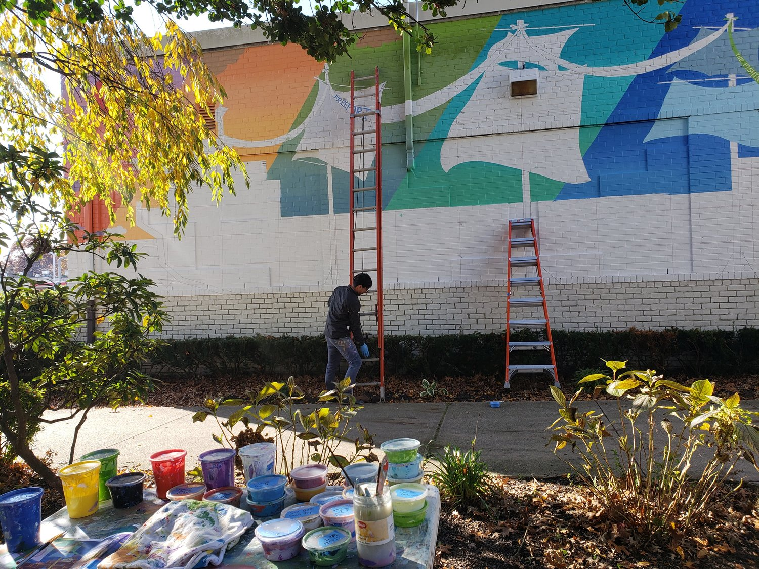 Ji Yong Kim, an artist and adjunct professor at Nassau Community College and Raritan Valley Community College in New Jersey, was selected by the Long Island Arts Council at Freeport to paint the mural. It took two months to complete.