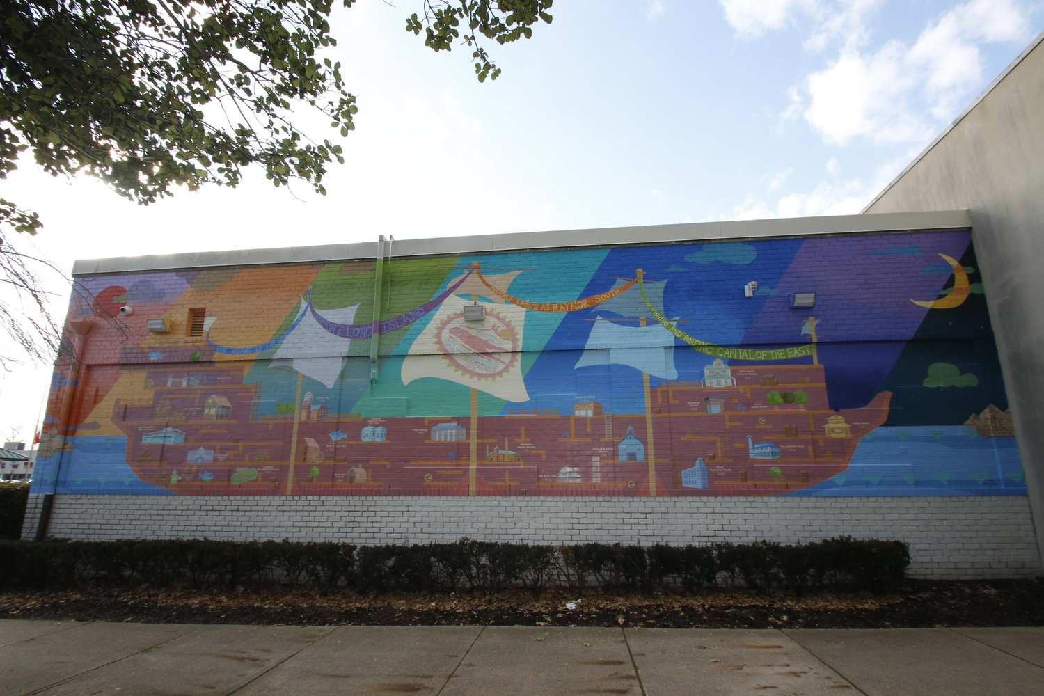 The mural includes over 20 historical landmarks or symbols that represent the Village.