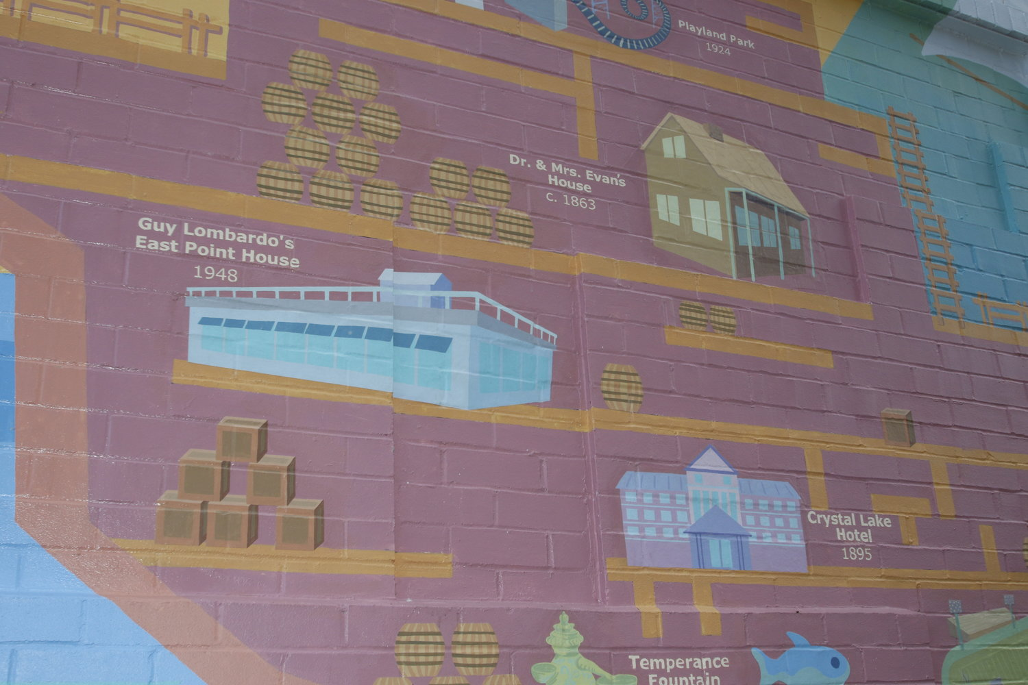 At first glance, the mural is a massive boat, but upon closer inspection, includes detailed pictures of nautical trinkets, barrels and ladders.