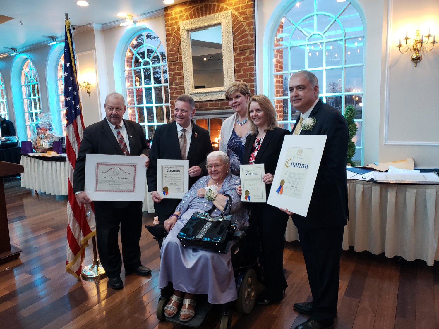 Native Freeporter Barbara Jagnow, center, was named the Business Person of the Year by the chamber and was presented with a number of awards and citations from elected officials.