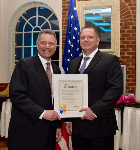 Nassau County Legislator Steve Rhoads, left, presented Patrick Franzone with a citation during the chamber dinner dance.