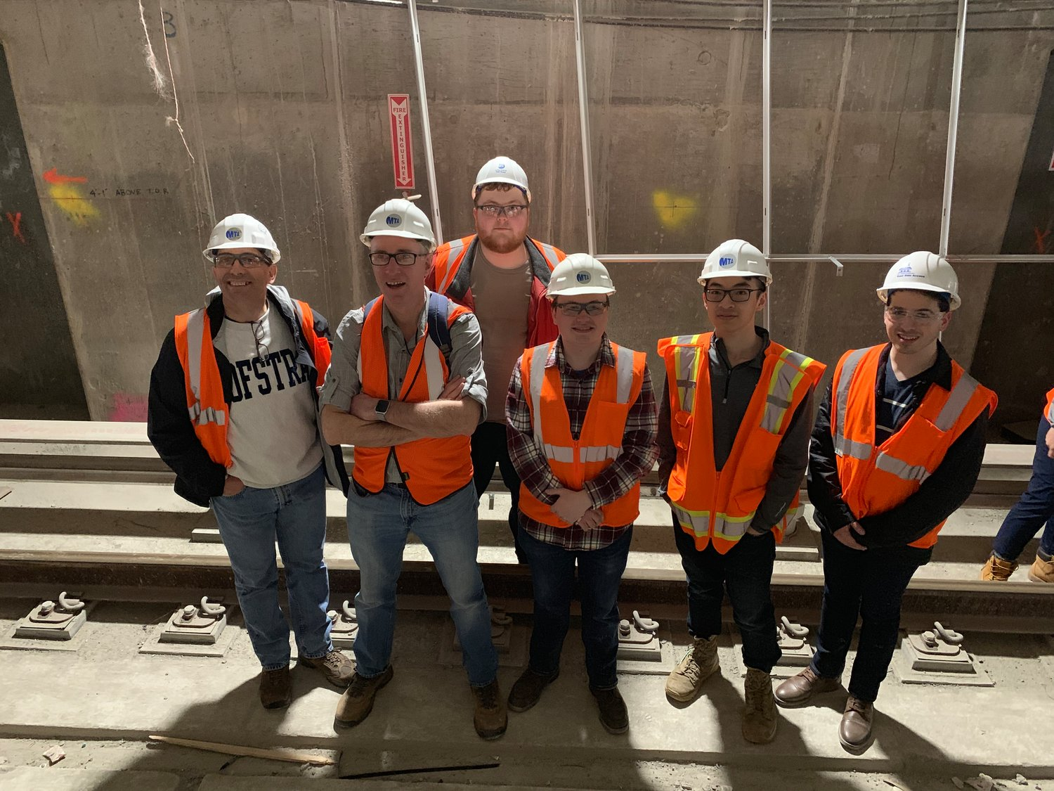 Students, professors and school officials from Hofstra University toured the Metropolitan Transportation Authority's East Side Access project in New York City earlier this month. Among the group were, from left, Hofstra Dean of Honors college professor Warren Frisina; geology professor Dr. Bret Bennington, of West Hempstead; and students Christopher Heilig, Ryan Leighton, Austin Nguyen and Jeffery Schmelkin.