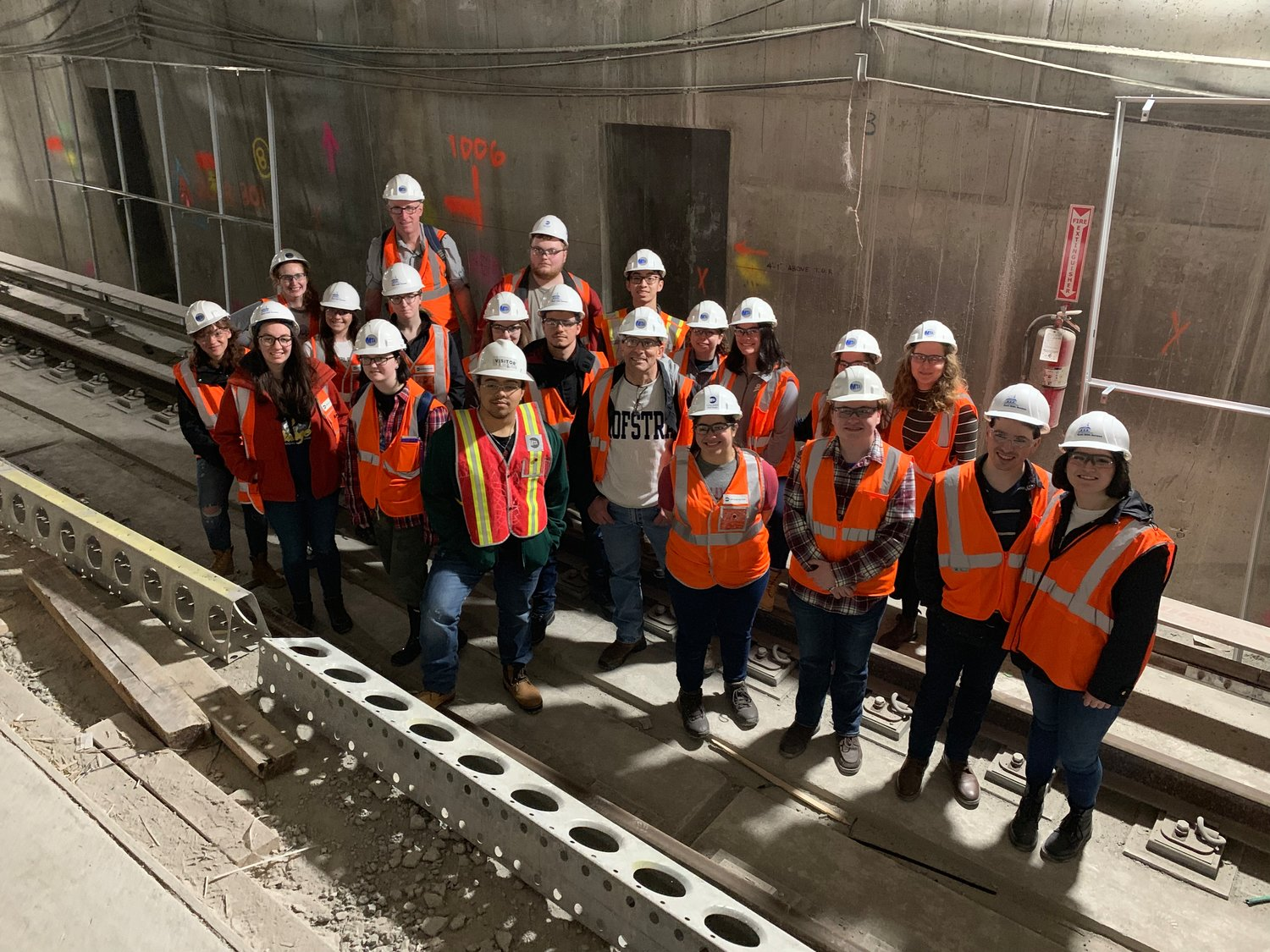 Students and school officials from Hofstra University took part in the tour.