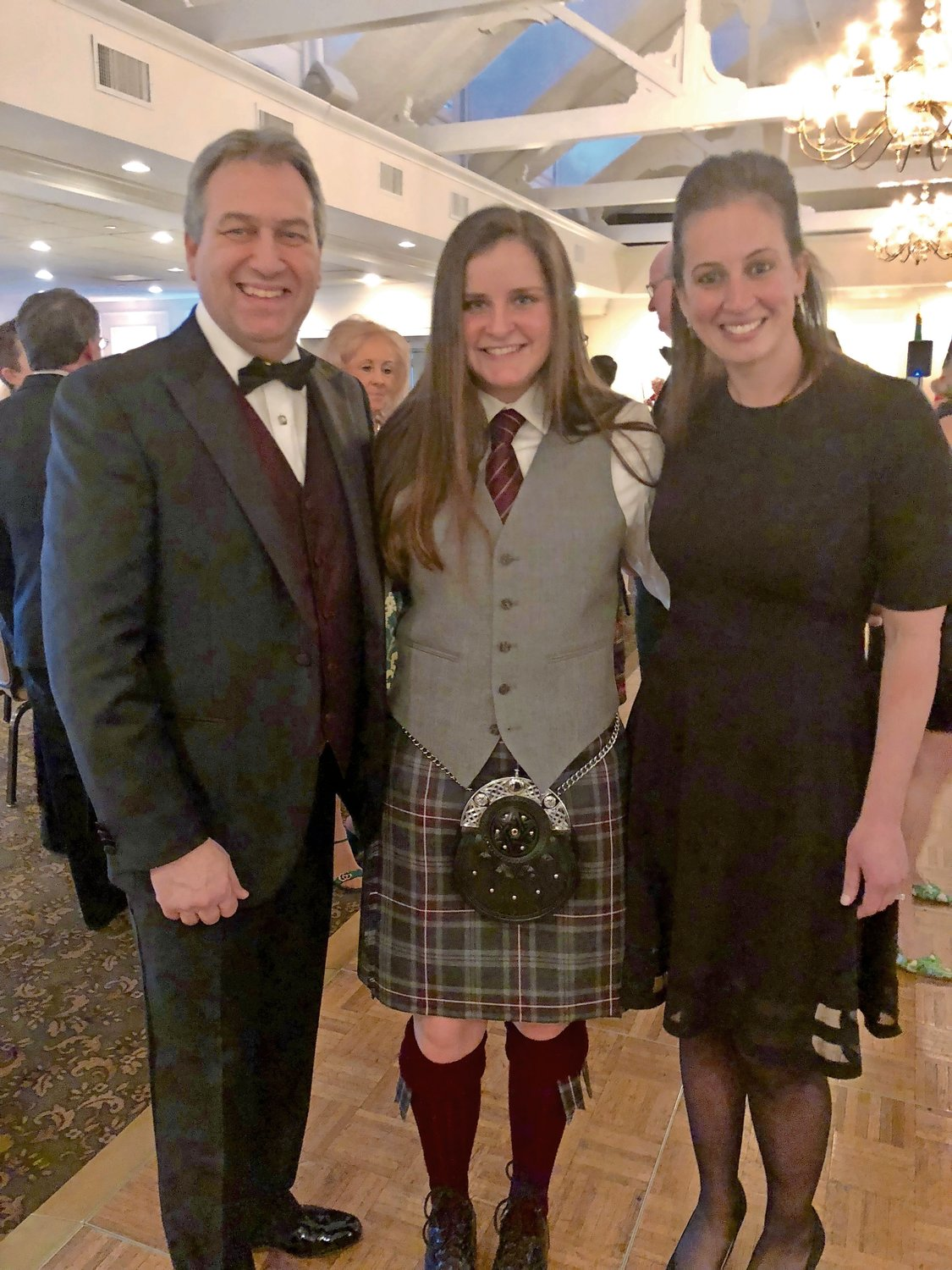 Erin McGrath, center, was invited by Molloy College President Drew Bogner and Vice President of Student Affairs Janine Payton to create a pipe band on campus.