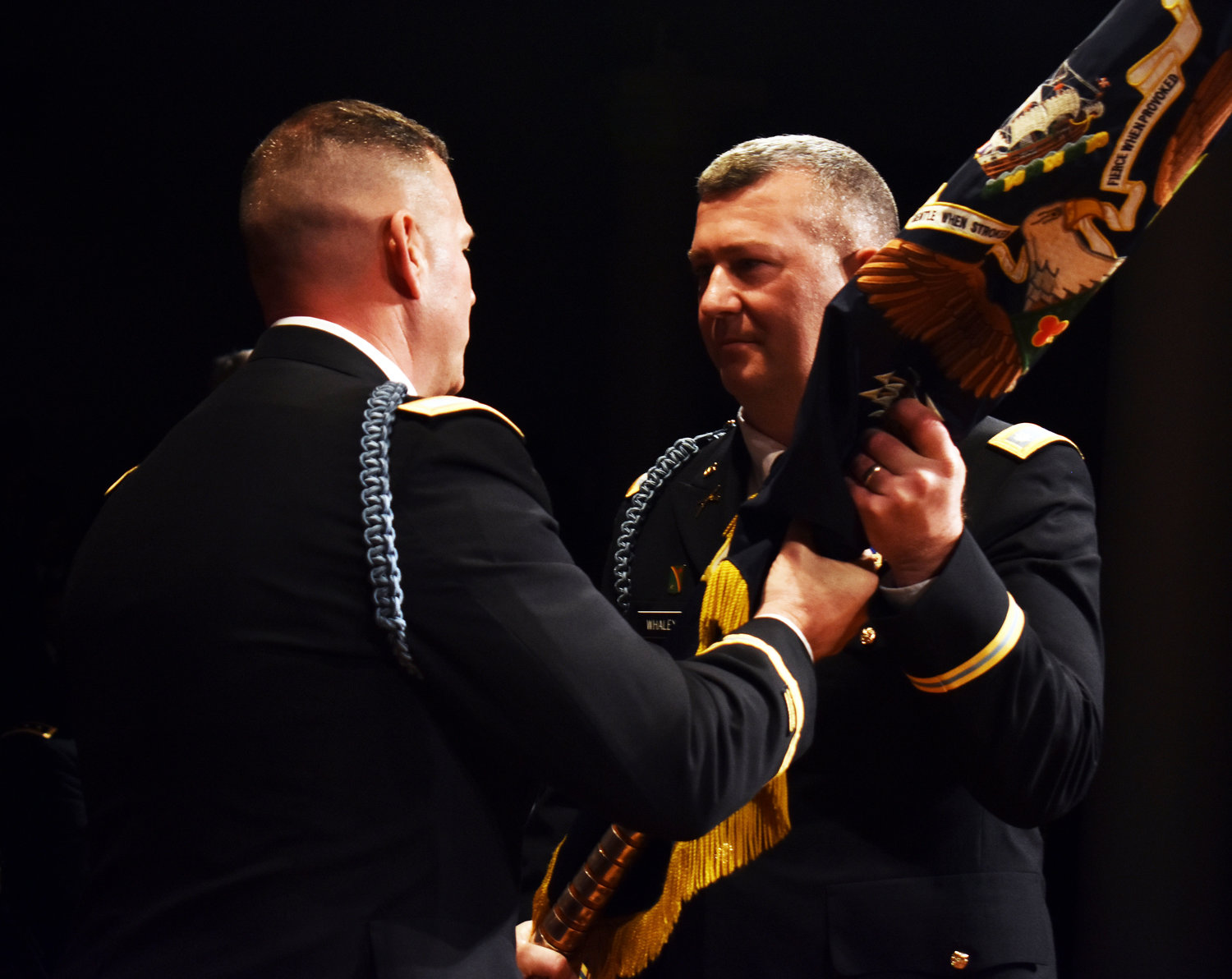 Lt. Col. Joseph Whaley, right, received the colors of the 1st Battalion, 69th Infantry from Col. Christopher Cronin, the commander of the 27th Infantry Brigade Combat Team, during change of command ceremonies held on March 16 at the Cooper Union in Manhattan.