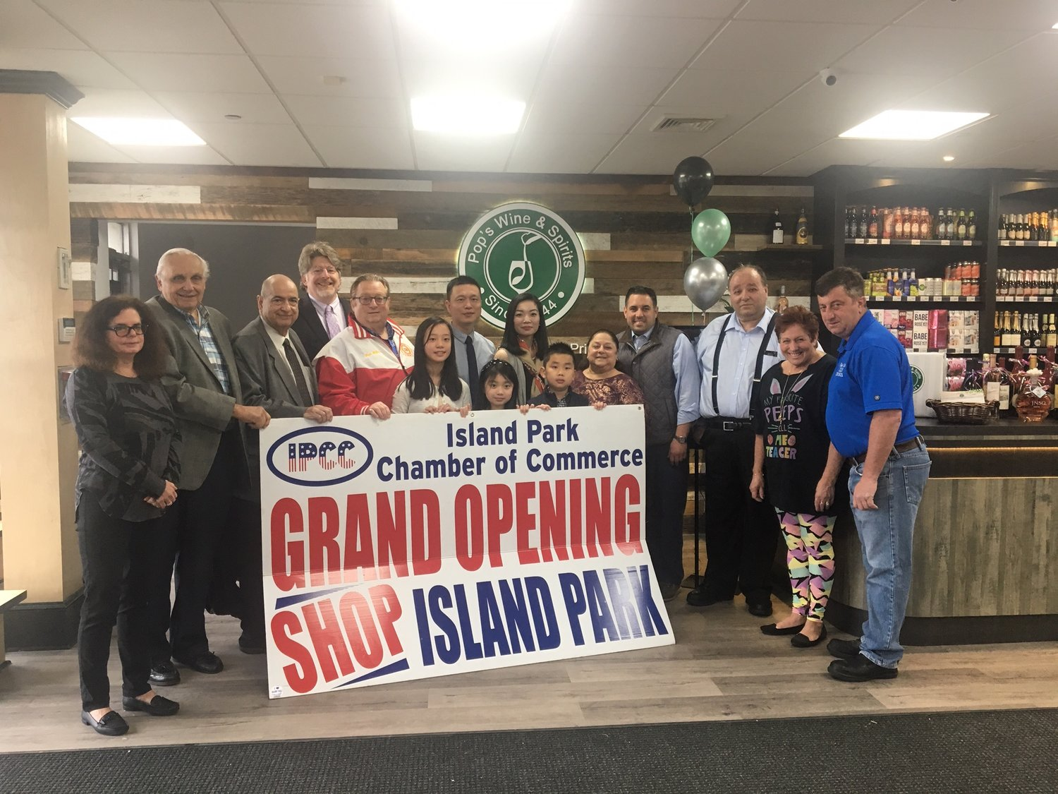 After being operated by the Poulos family for more than 70 years, Pop's Wine & Spirits' new owners, Chu and Ting Lin, celebrated its reopening with a ribbon-cutting last Saturday, which was attended by residents, elected officials and members of the Island Park Chamber of Commerce.