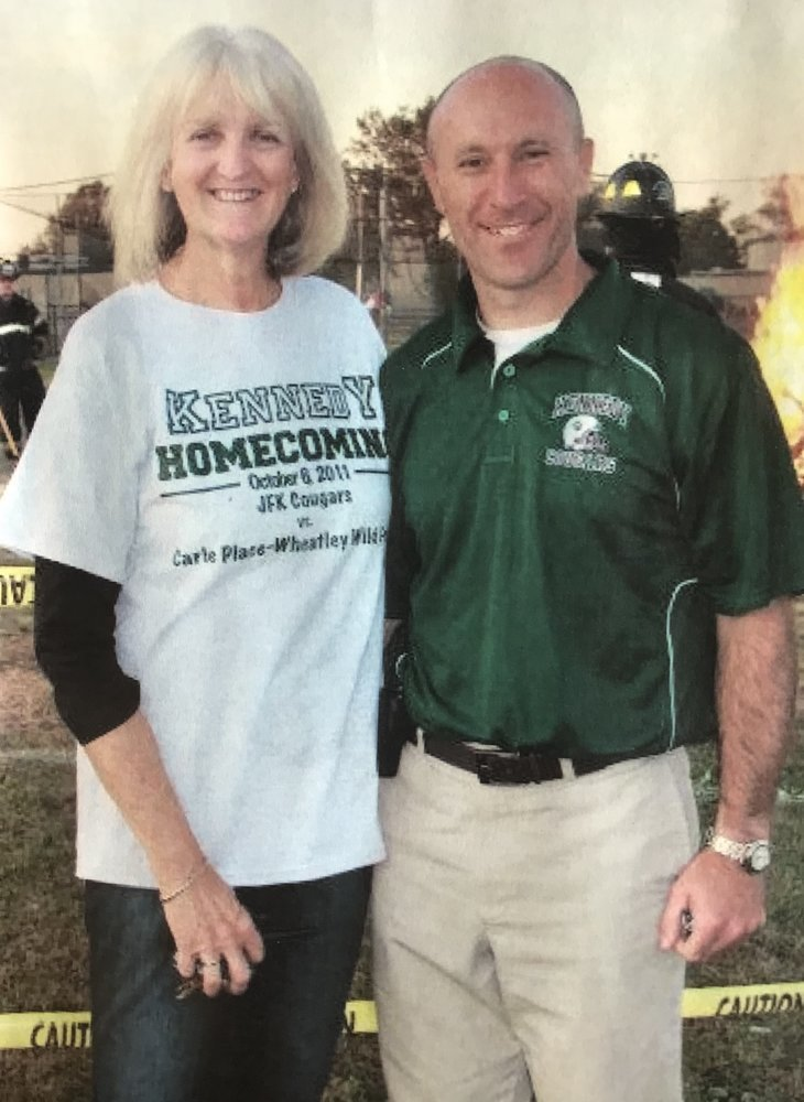 Poppe with current Kennedy Principal Gerard Owenburg at Kennedy''s 2011 Homecoming