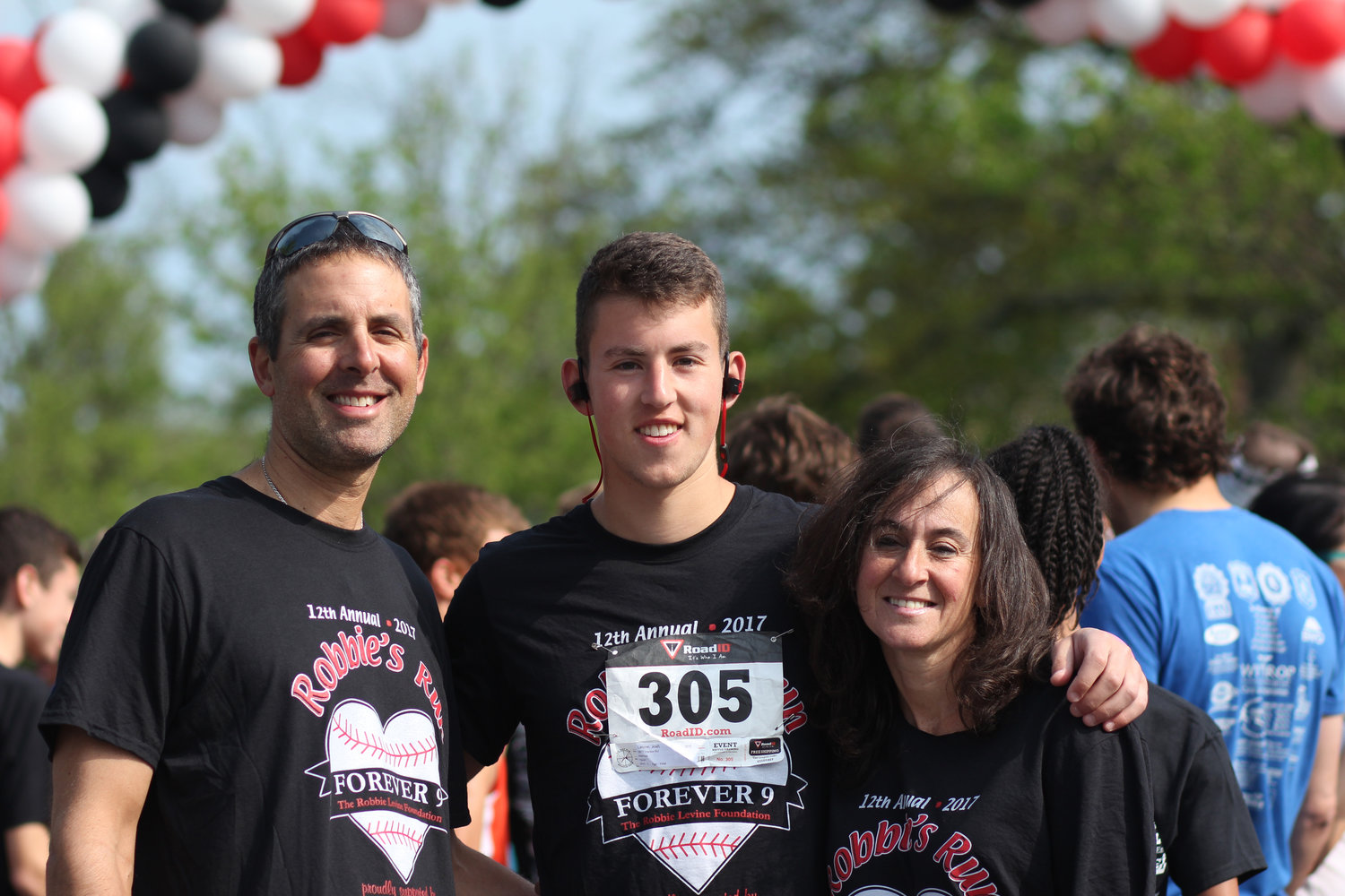 Jill Levine with her two sons, Craig, far left, and Joshua, at the 2017 Robbie's Run.