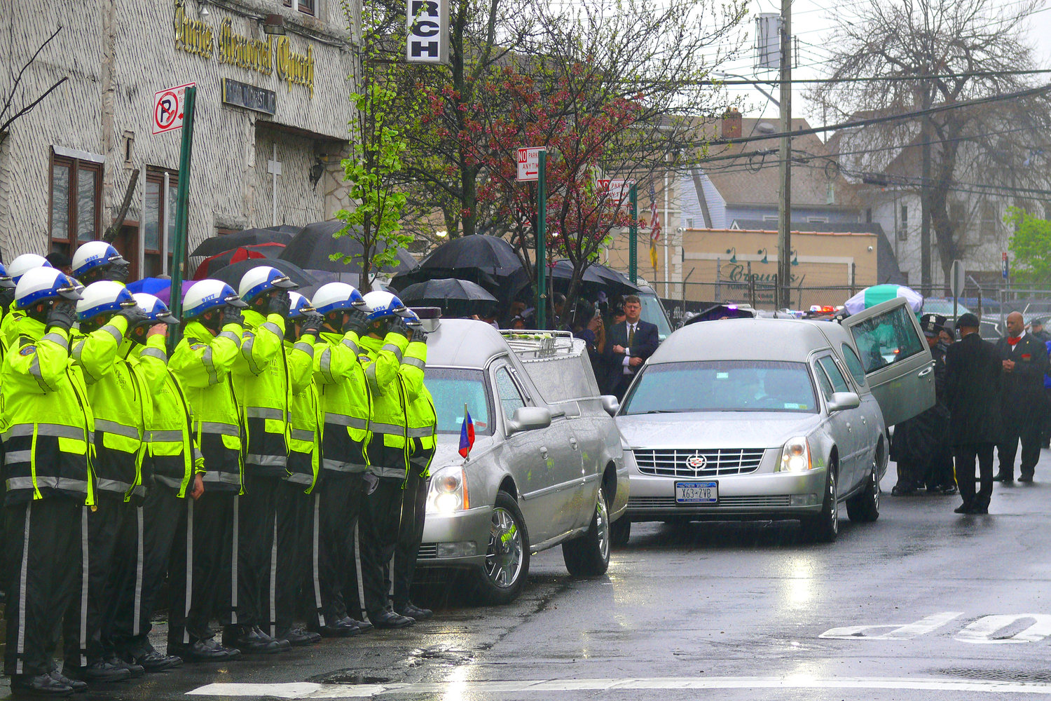 New York Police Department Highway Patrol Officers saluted their fallen comrade, Marc St. Arromand, of Elmont, outside the Burns Memorial Church of God on April 20.