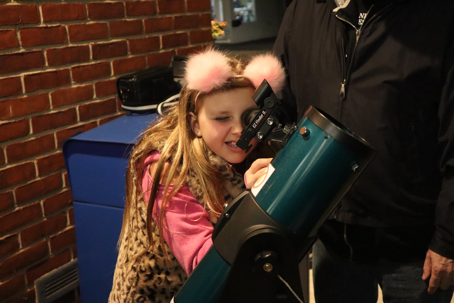 Tom Lynch's ongoing effort to introduce astronomy equipment to Long Island libraries recently brought him to the Bellmore Memorial Library. His goal is to inspire young minds like Taylor Shea's, who gazed at the moon through the library's new telescope on April 15.