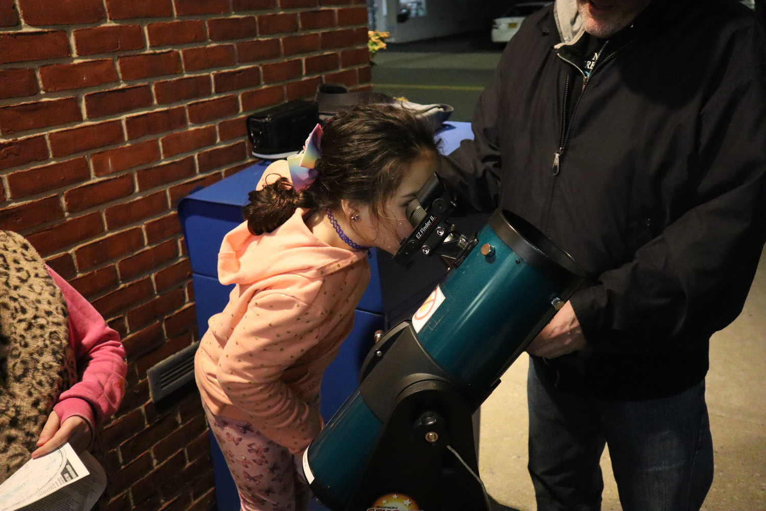 mckayla was excited to see the moon through the Bellmore Library's new telescope. Now she's just waiting to borrow it, she said.