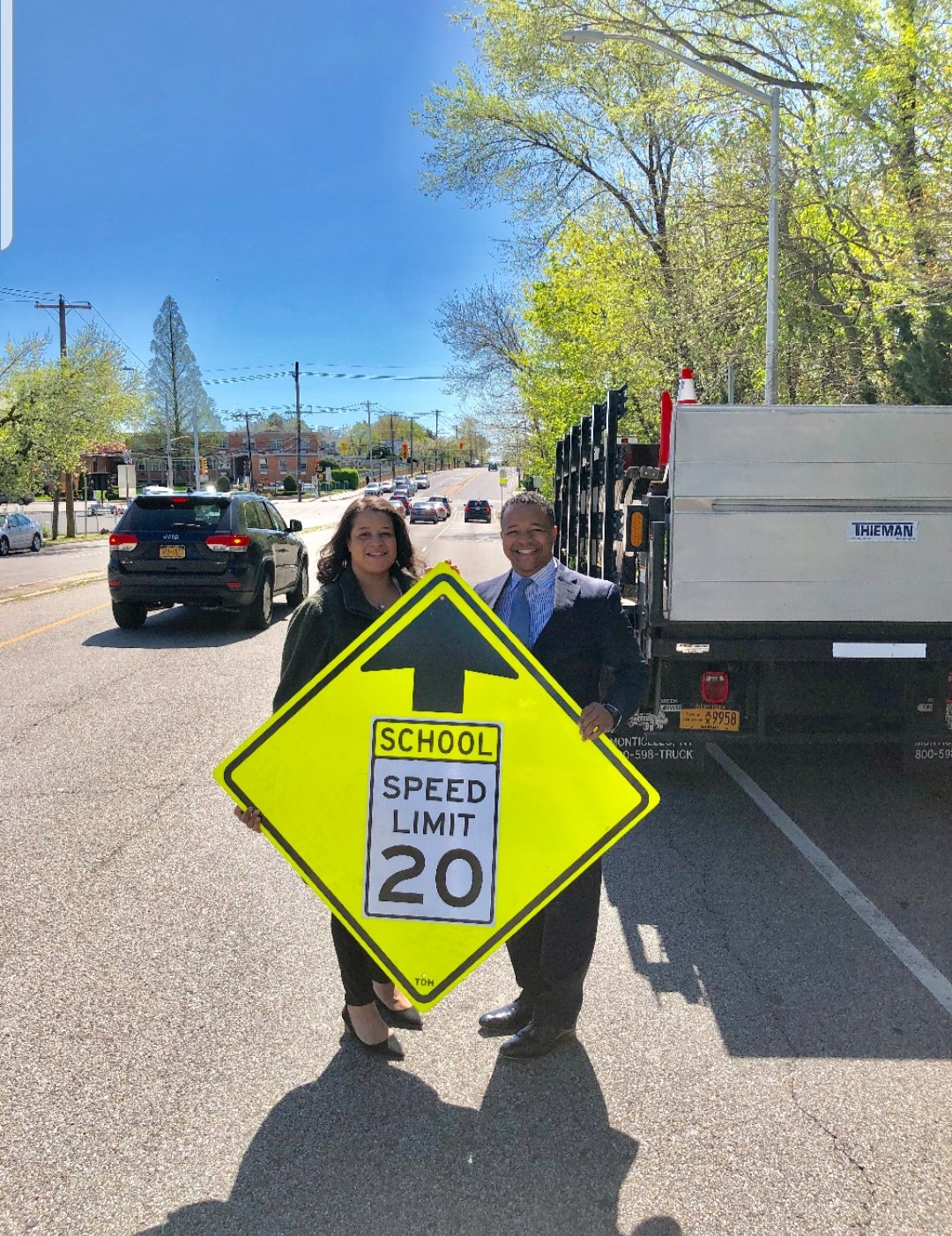 New York State Assemblywoman Michaelle Solages and Nassau County Legislator Carrie Solages helped install the new school zone sign by Astor Street.
