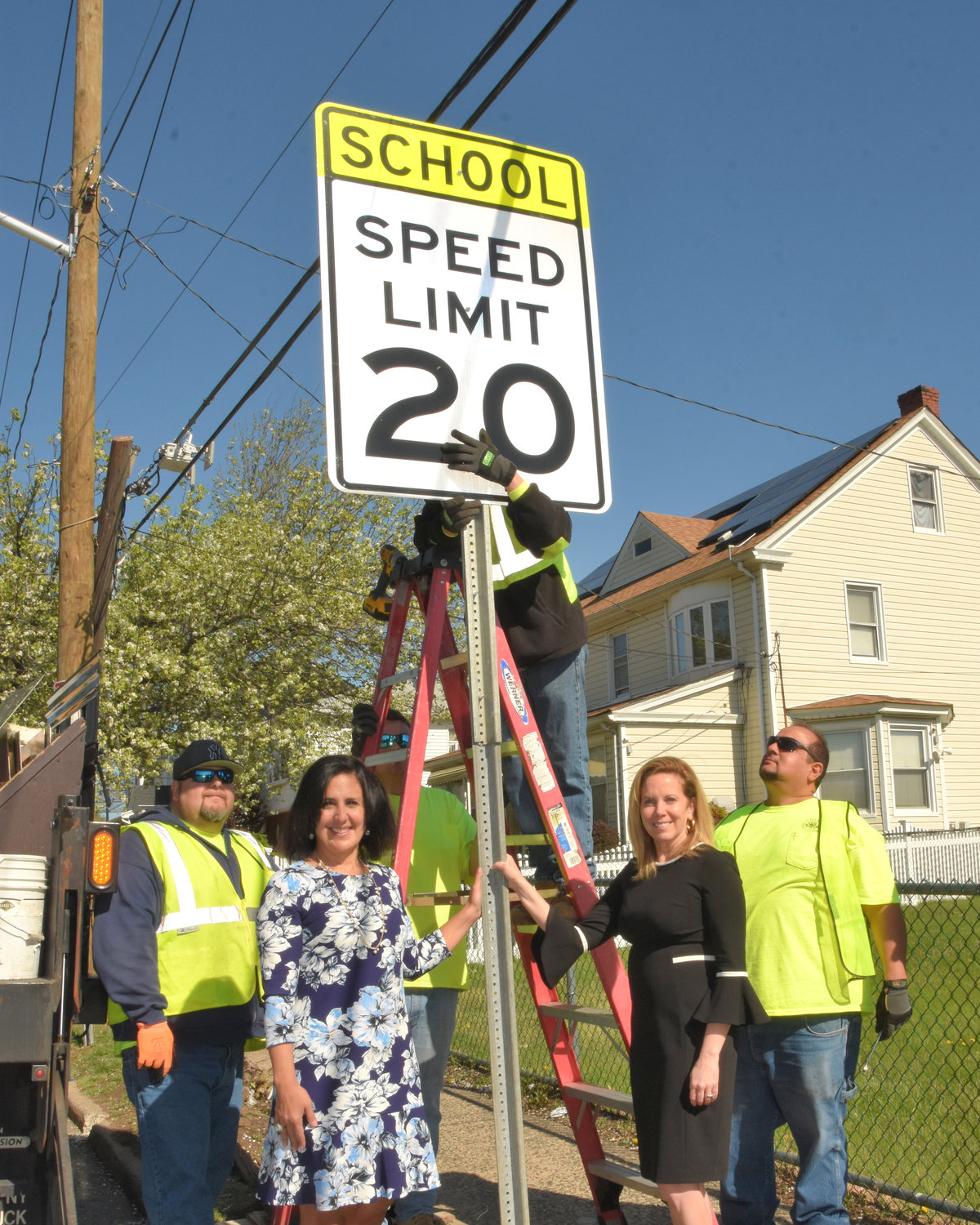 Town of Hempstead Supervisor Laura Gillen, right, and Town Clerk Sylvia Cabana oversaw the installation of the school zone sign near Elmont Road.