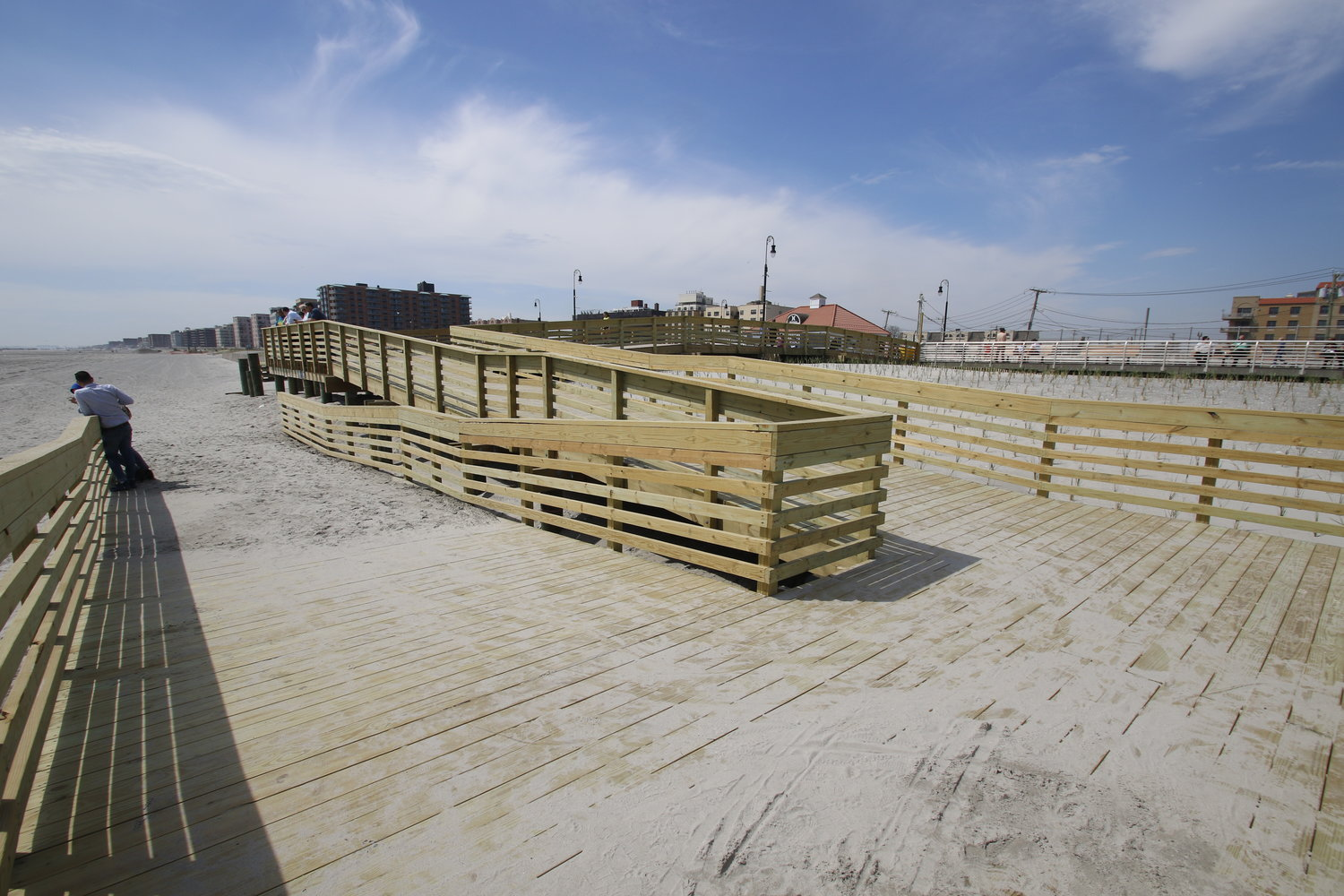 The coastal protection project features 25-foot-wide, 14-foot-high dunes running parallel to the boardwalk and 15 dune crossovers that connect the boardwalk to the beach. Officials said that the work is complete, except for certain crossovers and dune plantings.