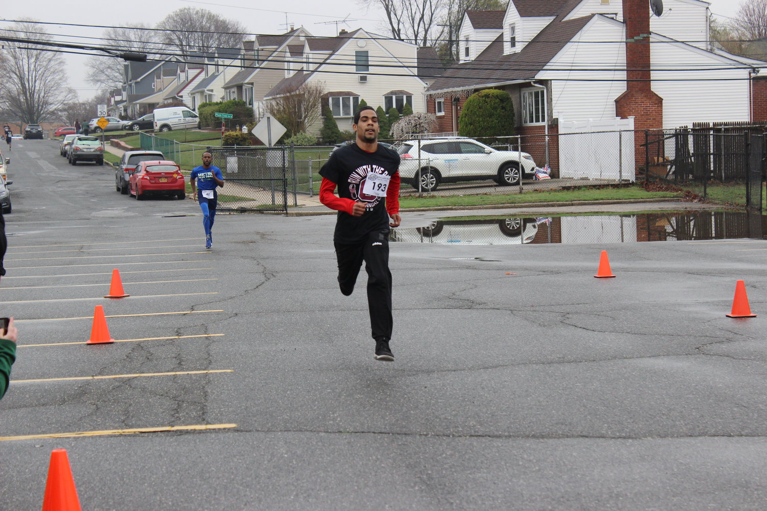 Mark Reyes shot ahead of Feurtado at the finish line. Reyes, an independent runner from Hempstead, said he spotted the race online and jumped at the opportunity to compete.
