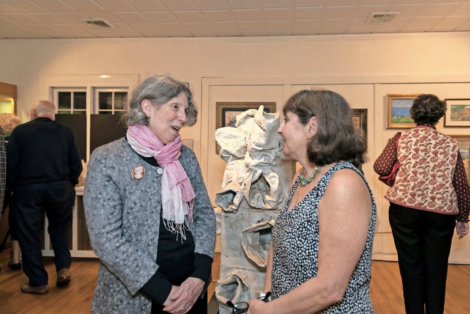"In 2017, Artist Barbara Bell, left, and Reres, who was then the museum's executive director, at the opening reception of ""Sea Cliff Through the Artist's Eye."""