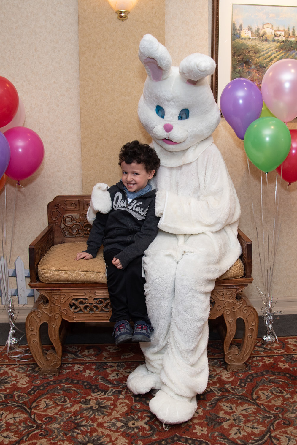 Enrico Gonzales, 4, made a new friend at the Regency — the Easter Bunny.