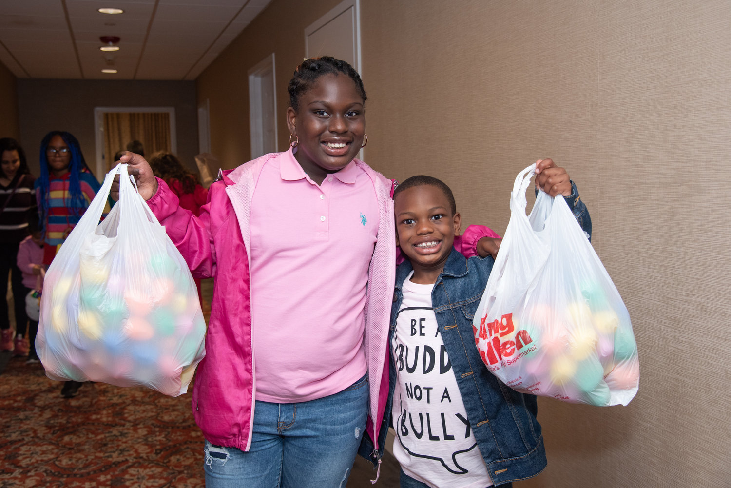 Payton, 10, and Danen Pitlman, 6, had bags-full of eggs to bring home.