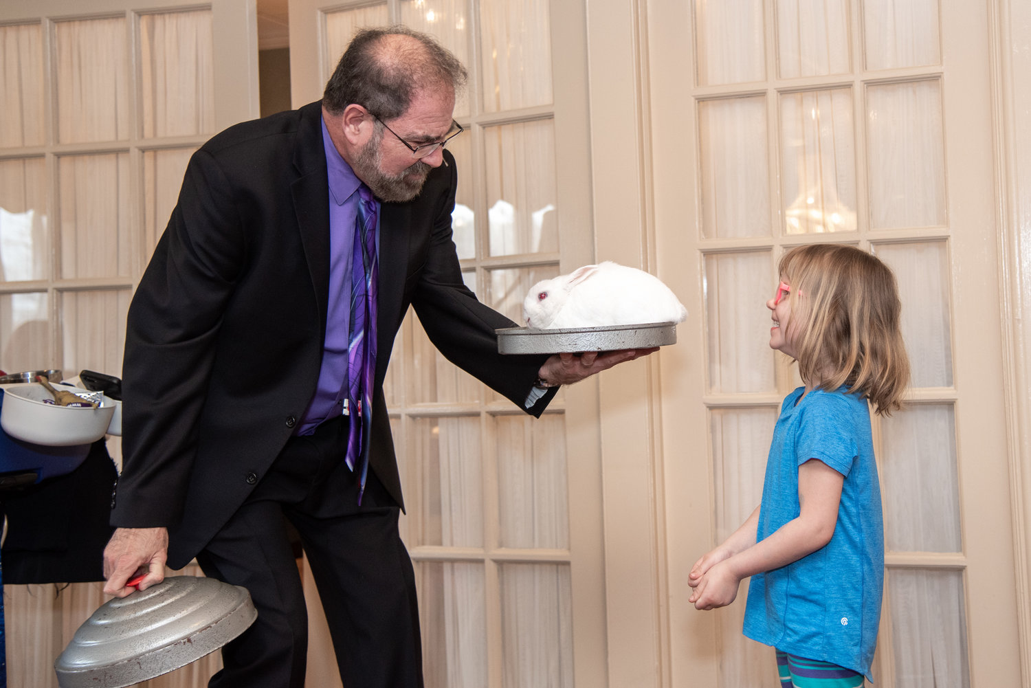Julianne Klein, 5, was amazed by magician Dave Funn's disappearing/reappearing bunny trick at the Regency Assisted Living center.