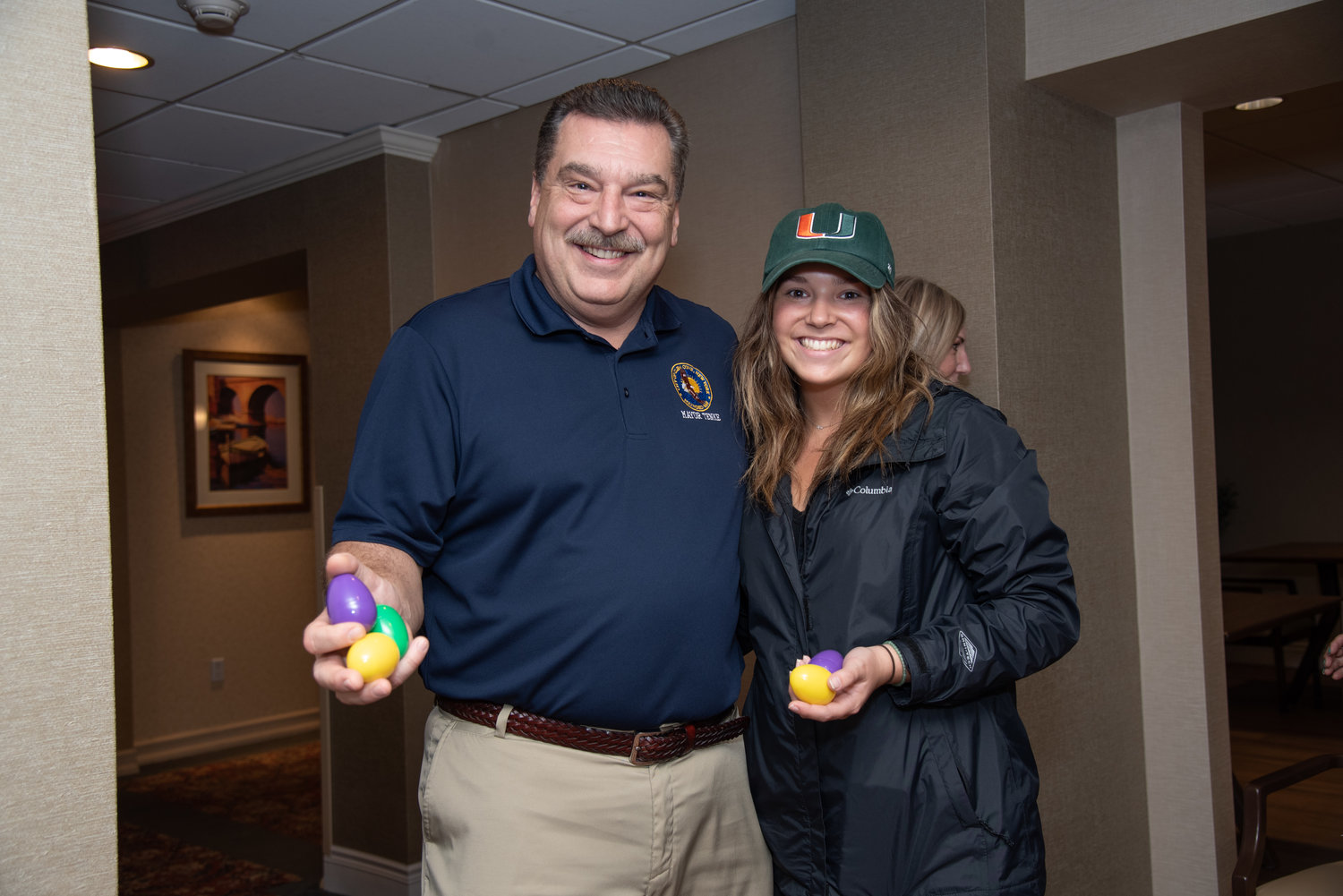 Glen Cove Mayor Tim Tenke collected eggs with his daughter, Grace.