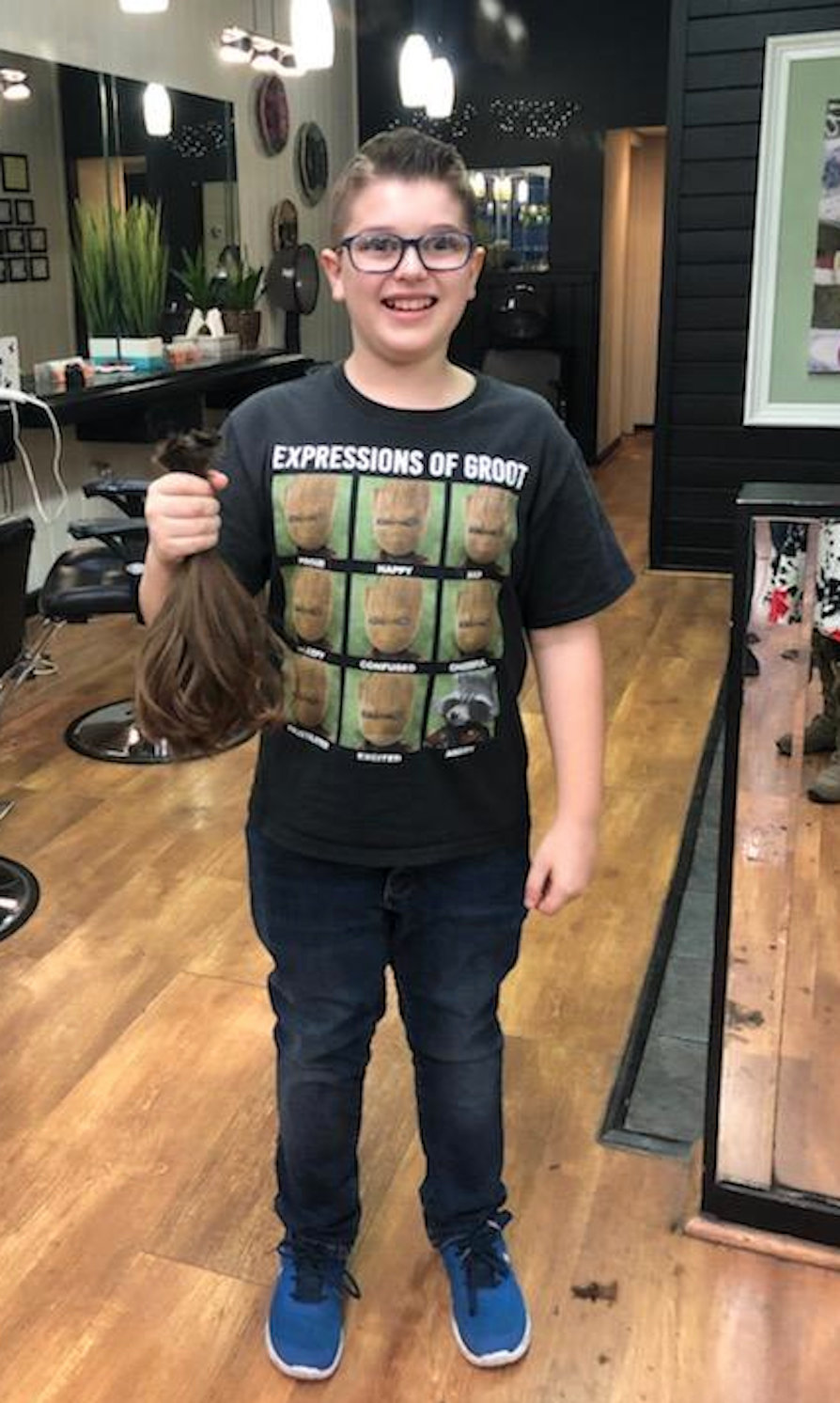 Noah Dzienius, before his most recent haircut. He let his hair grow long to have it cut to help cancer patients.