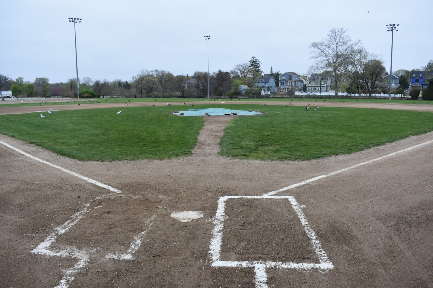 Parents and players have successfully advocated for some improvements to the field, where the South Side High School varsity baseball team plays its home games, and now look to add other amenities, including a scoreboard and batting cages.