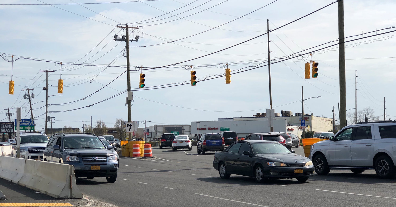 The traffic pattern on Rockaway Turnpike in Lawrence has vehicles veering east and west in close quarters as the Nassau Expressway renovation project progresses.