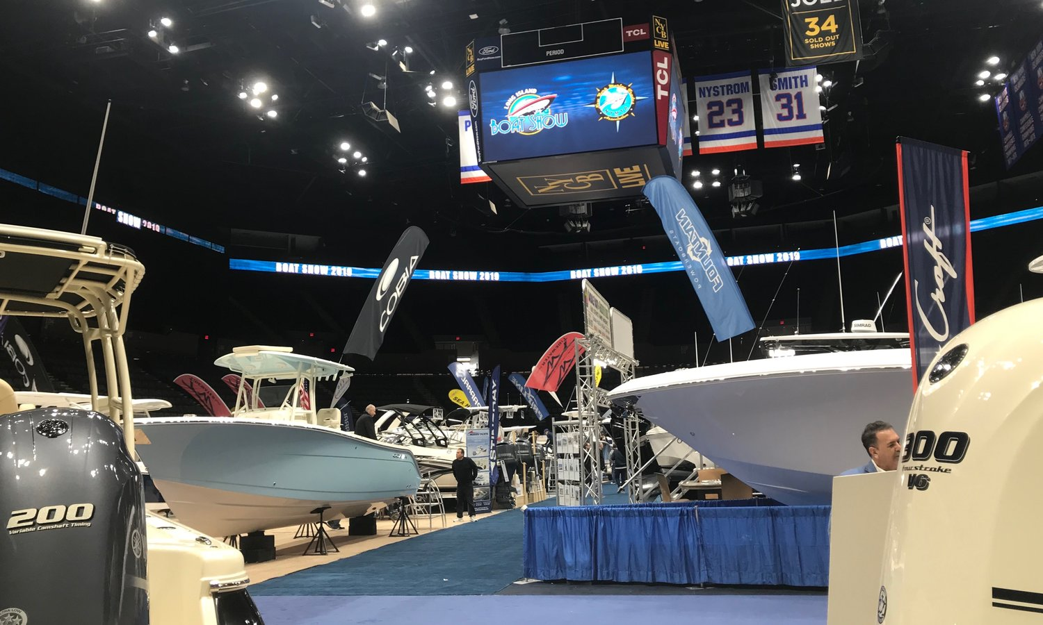 The floor of Nassau Coliseum filled with all different types of boats. People of all ages attended.