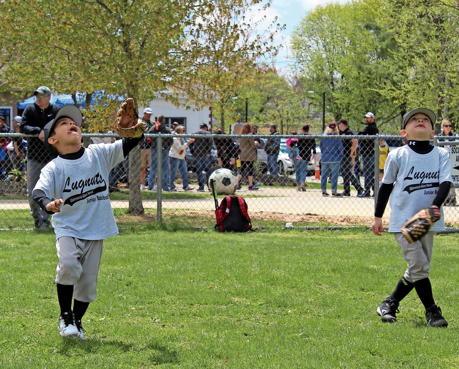 Avery Cordero, left, of the Lugnuts, focused on a fly ball coming his way as his teammate, Connor Cleary, looked on.