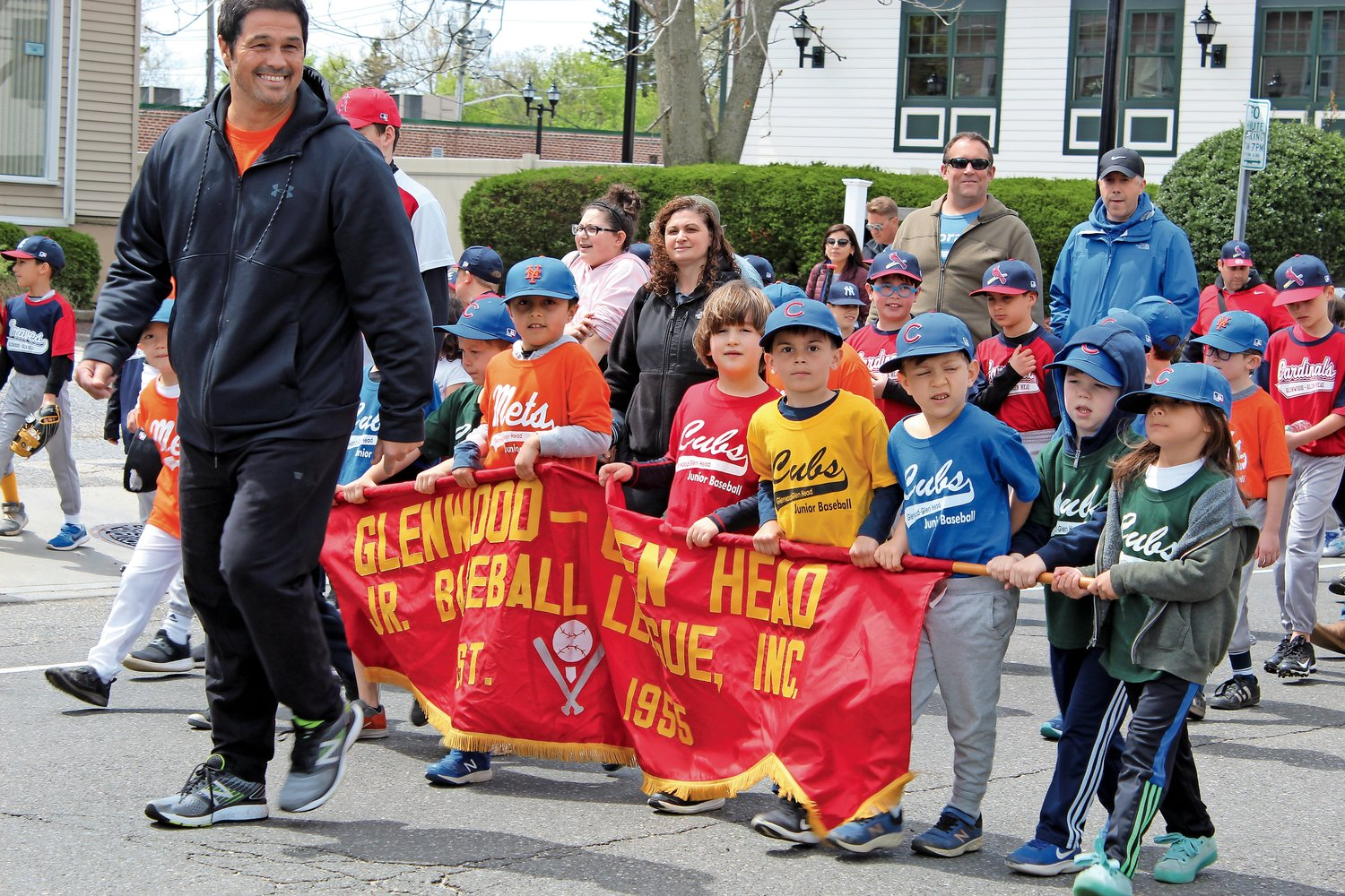 Coach Billy Golden, of Glen Head, led some pint-sized sluggers on the parade route.