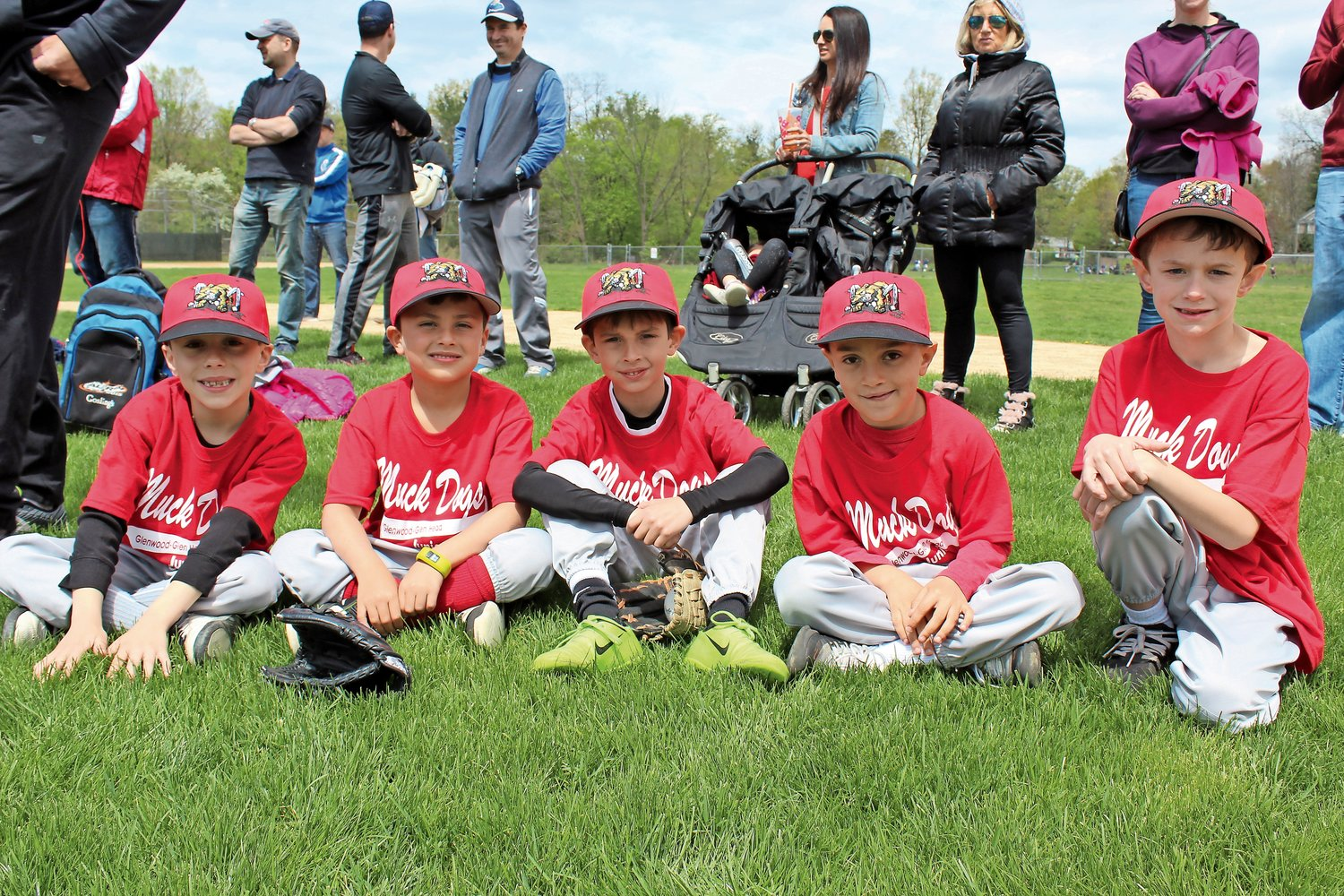 Muck Duck teammates, from left, Theo Roumas, Cole Betinetti, Logan Taveira, Benny Sosa and Mikey Wagner in the infield after the parade.
