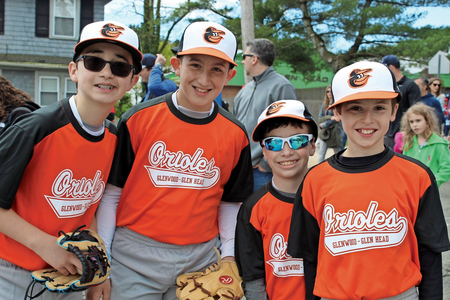 Along the parade route, some of the Orioles stopped for a photo, including, from left, Greg Luzhansky, Vincenzo Sicuranza, Jordan Eisbruck and Jeffrey Bartlett.
