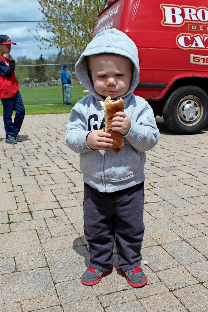 Future slugger Cameron Puhalski, 18 months, enjoyed a hot dog on opening day.