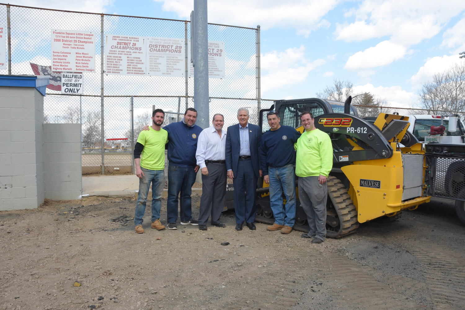 Town of Hempstead Department of Highways Commissioner Thomas Toscano, third to the left, and Councilman Bruce Blakeman, right, joined Parks and Recreation employees to oversee renovations at Rath Park.