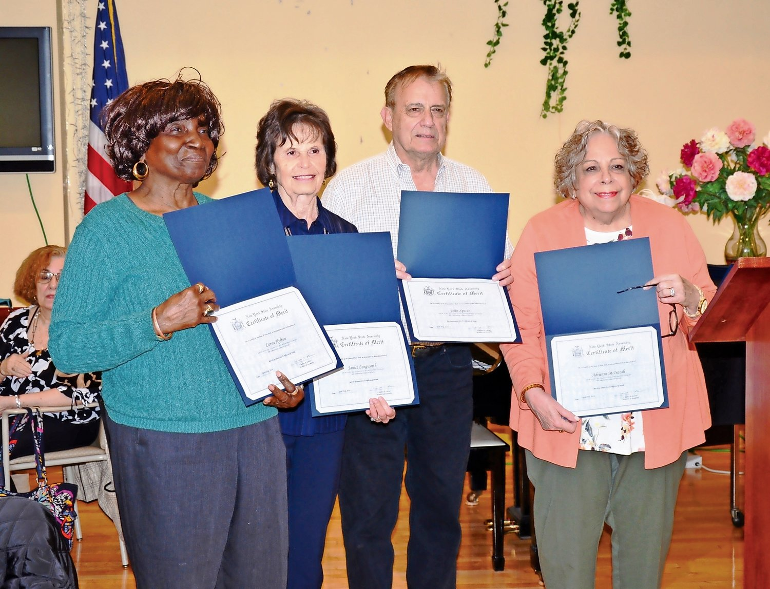It was a proud day for Lorna Hylton, left, Janice Longworth, John Speece and Adrienne McIntosh, who were recognized for their volunteerism.